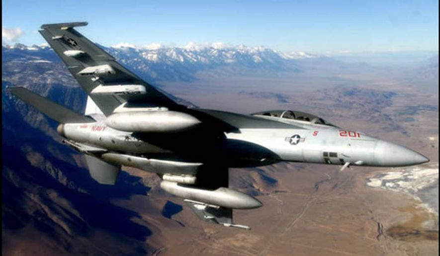 F/A-18 flies above the Sierra and Coso mountain ranges. (U.S. Navy)