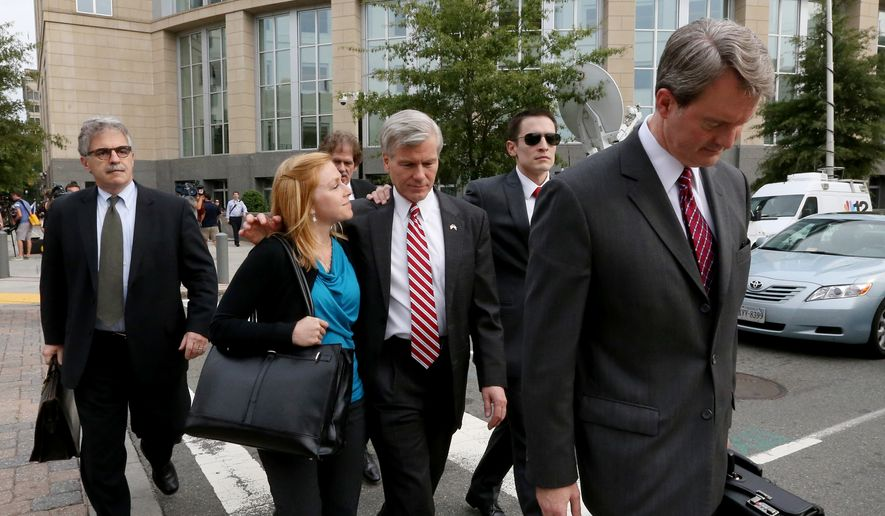 """Former Virginia governor Bob McDonnell, walks with his daughter Cailin Young as he leaves the federal courthouse Thursday, Aug. 21, 2014 in Richmond, Va. Former Virginia Gov. Bob McDonnell wrote a long, forlorn email to his wife three years ago trying to save his marriage, calling her his """"soulmate,"""" yet he also said he grew so weary of her yelling that he began taking refuge in his office late at night rather than go home.  (AP Photo/Richmond Times-Dispatch, Bob Brown)."""