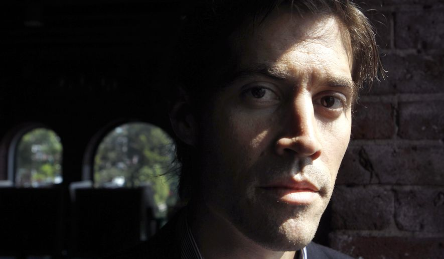 FILE - In this May 27, 2011, file photo shows American Journalist James Foley, of Rochester, N.H., as he poses for a photo in Boston. The beheading of Foley has forced a new debate over how the United States balances its unyielding policy against paying ransom to terrorist groups and saving the lives of Americans being held hostage by some of the world's most dangerous extremists. (AP Photo/Steven Senne, File)