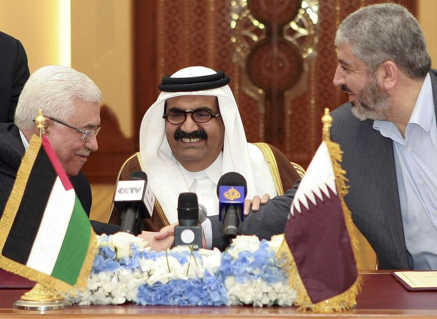 ** FILE ** In this Monday, Feb. 6, 2012 file photo, Palestinian President Mahmoud Abbas, left, shakes hands with Hamas leader Khaled Mashaal, right, as the then Emir of Qatar, Sheik Hamad bin Khalifa Al Thani, looks on after signing an agreement in Doha, Qatar. The explosions rocking the Gaza Strip may seem far removed from the flashy cars and skyscrapers of ultra-rich Qatar, but efforts to end fighting between Hamas and Israel could hinge on how the tiny Gulf state wields its influence over a militant group with few friends left. (AP Photo/Osama Faisal, File)