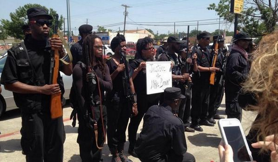 Black gun-rights activists in Texas protested police brutality on Wednesday by exercising their rights to openly carry firearms through the streets of South Dallas. (Twitter/@HueyGunClub)
