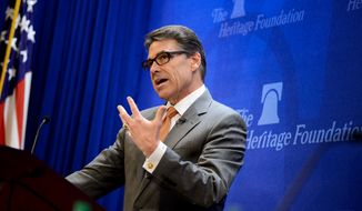 """Texas Gov. Rick Perry speaks during a discussion on """"The Border Crisis and the New Politics of Immigration"""" at the Heritage Foundation, Washington, D.C., Thursday, August 21, 2014. (Andrew Harnik/The Washington Times)"""