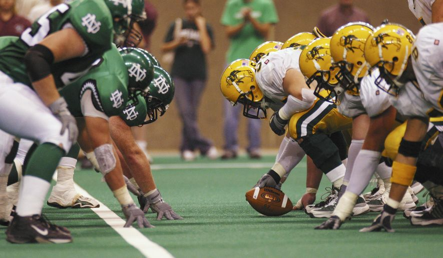 This Oct. 18, 2003 photos shows the North Dakota State offense ready to snap the ball against North Dakota during an NCAA football game in Grand Forks, N.D. The longstanding football rivalry between the schools that fell apart a decade ago is back. North Dakota State and University of North Dakota officials announced Friday, Aug. 22, 2014, that the schools will play Sept. 19, 2015, at the Fargodome in Fargo. The game was once billed as the longest-running rivalry in NCAA Division II football. (AP Photo/Courtesy of the University of North Dakota Athletics Department)