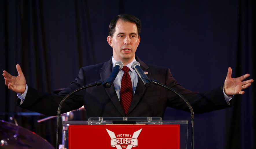 FILE - In this Friday, Aug. 8, 2014, file photo, Wisconsin Republican Gov. Scott Walker speaks at the Republican National Committee summer meetings in Chicago. Court documents released Friday, Aug. 22, 2014, show  that Wisconsin Gov. Scott Walker's recall election campaign team told him to instruct donors to give to Wisconsin Club for Growth, which would run ads for Walker and distribute money to other conservative groups backing him. The emails were part of some 1,300 pages released by a federal appeals court from a secret investigation into whether Walker's recall campaign illegally coordinated with conservative groups. (AP Photo/Kamil Krzaczynski, File)