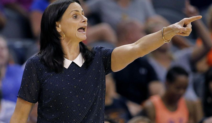 FILE - This is a July 2, 2014, file photo, showing Phoenix Mercury head coach Sandy Brondello calling a play during the first half of a WNBA basketball game against the Chicago Sky in Phoenix. A person close to the situation says Brondello has won the WNBA coach of the year award. The person says Brondello will receive the award Friday night, Aug, 22, 2014,  in Phoenix before the Mercury host Los Angeles in the Western Conference semifinals opener. (AP Photo/Matt York, File)