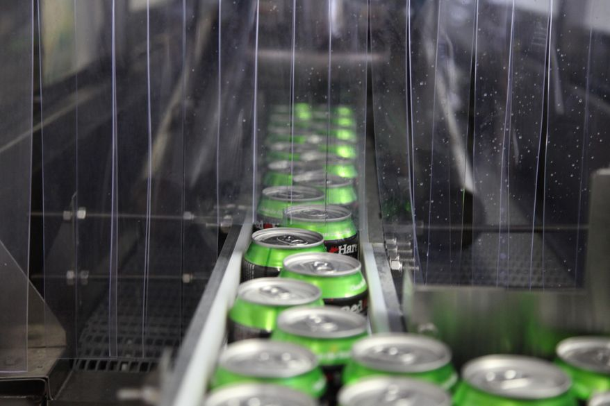 In this photo taken on July 22, 2104, Red Hare Brewing Company beer cans move down the production line at the microbrewery's canning facility in Marietta, Ga. (AP Photo/Johnny Clark) **FILE**