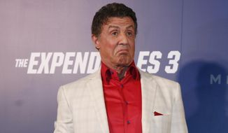 "U.S. actor Sylvester Stallone gestures on the red carpet for the Macau premiere of his movie ""The Expendables 3"" in Macau, China, Friday, Aug. 22, 2014. (AP Photo/Kin Cheung) ** FILE **"