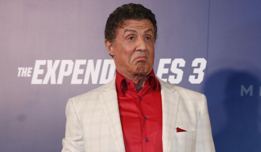 """U.S. actor Sylvester Stallone gestures on the red carpet for the Macau premiere of his movie """"The Expendables 3"""" in Macau, China, Friday, Aug. 22, 2014. (AP Photo/Kin Cheung) ** FILE **"""