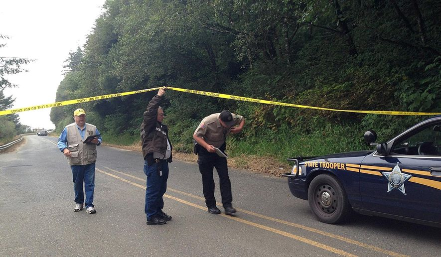"""FILE - In this Aug. 19, 2014 file photo, investigators leave the scene of a drive-by shooting at Bastendorf Beach, Ore. A gunman who fatally shot his father and then a man camping at an Oregon beach left a suicide note that said he was mentally ill and planned to """"kill a bunch of other people"""" and then himself. Coos County District Attorney R. Paul Frasier released the notes Friday, Aug. 22, 2014. (AP Photo/KCBY, Angelica Carrillo, File)"""
