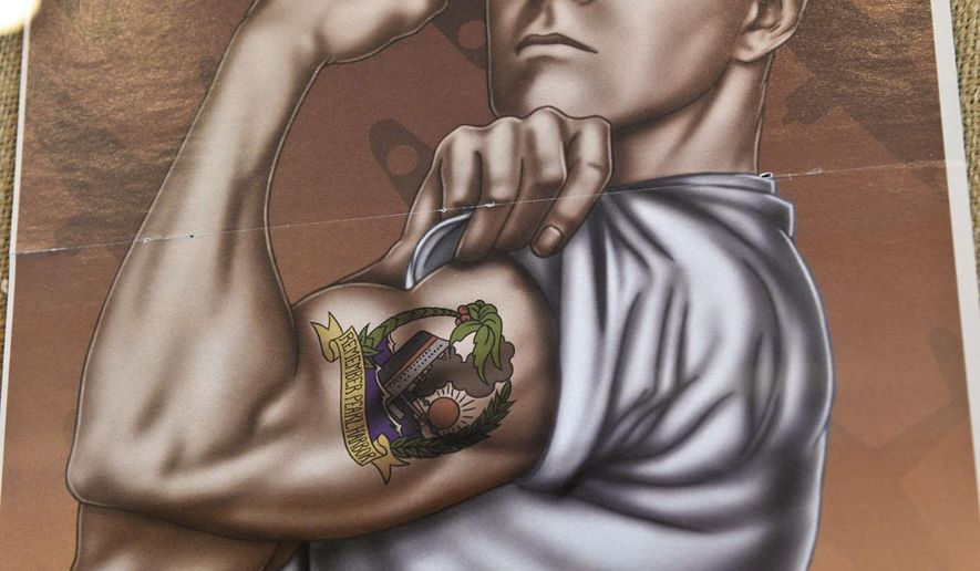 ADVANCE FOR SATURDAY AUG. 23 - In this photo taken on Tuesday, Aug. 12, 2014, a poster depicting a sailor with a tattoo is displayed at the Tattoo Archive in downtown Winston-Salem, N.C. (AP Photo/Winston-Salem Journal, David Rolfe)