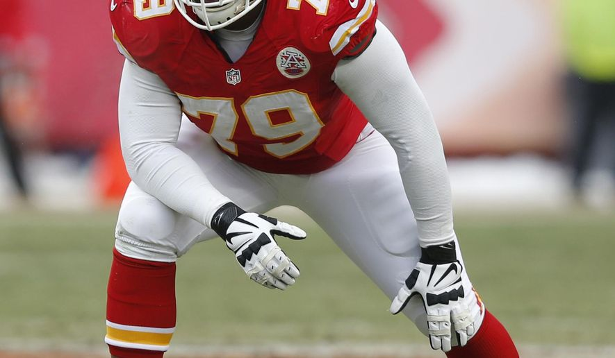 FILE - In this Dec. 22, 2013, file photo, Kansas City Chiefs tackle Donald Stephenson (79) waits for a play to start during the second half of an NFL football game against the Indianapolis Colts at Arrowhead Stadium in Kansas City, Mo. Stephenson has been suspended by the NFL for the first four games of the regular season for violating the league's policy on performance-enhancing substances. Stephenson was a fill-in starter last season but was expected to anchor the right side of the line this year. He remains eligible to participate in all preseason practices and games, including Saturday night's, Aug. 23, 2014,  game against Minnesota. (AP Photo/Ed Zurga, File)