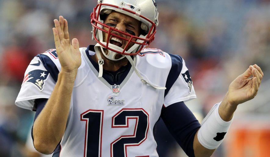 New England Patriots quarterback Tom Brady runs onto the field before an NFL preseason football game against the Carolina Panthers, Friday, Aug. 22, 2014, in Foxborough, Mass. (AP Photo/Charles Krupa)