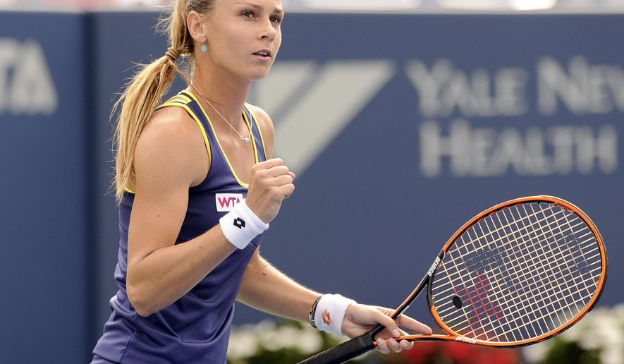 Magdalena Rybarikova, of Slovakia, celebrates during a quarterfinal match against Alison Riske at the New Haven Open tennis tournament in New Haven, Conn., on Thursday, Aug. 21, 2014. (AP Photo/Fred Beckham)