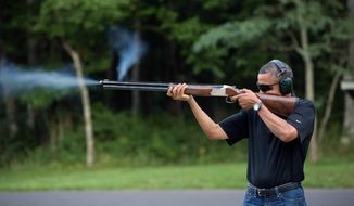 President Barack Obama shoots clay targets on the range at Camp David, Md., Saturday, Aug. 4, 2012. (Official White House Photo by Pete Souza)