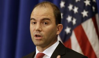Deputy National Security Adviser for Strategic Communications and Speechwriting Ben Rhodes speaks to reporters during a press briefing, Friday, Aug. 22, 2014, in Edgartown, Mass., on the island of Martha's Vineyard. (AP Photo/Steven Senne) ** FILE **