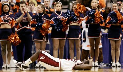9. BUCKNELL UNIVERSITY, LEWISBURG, PA. Arkansas guard Eric Ferguson (15) lies on the floor in front of the Bucknell cheer leaders after he was fouled during the second half of their NCAA tournament first-round basketball game against Bucknell in Dallas, Friday, March 17, 2006. Bucknell won 59-55. (AP Photo/Eric Gay)