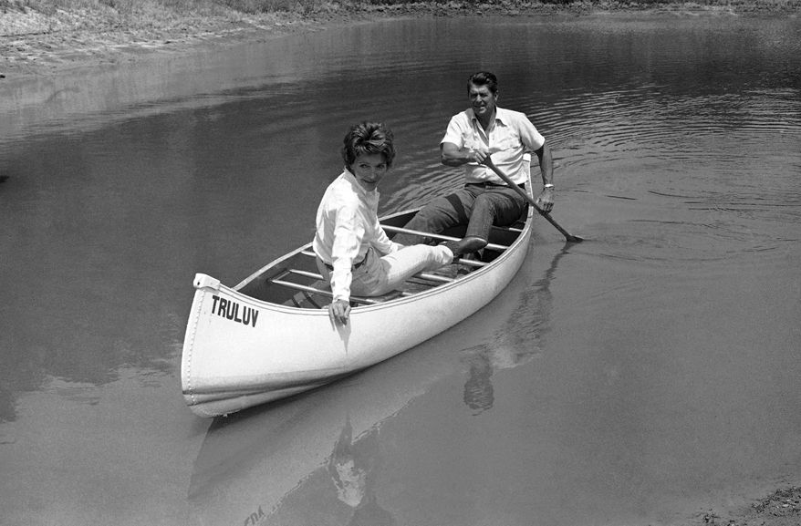 Ronald Reagan took his wife Nancy for a canoe ride on a pond at their mountain to ranch near Santa Barbara, Calif. on Monday, July 27, 1976 after announcing in Los Angeles that he had selected liberal republican U.S. Sen. Richard S. Schweiker as his vice presidential running mate if nominated at the GOP National Convention in Kansas city. (AP Photo)