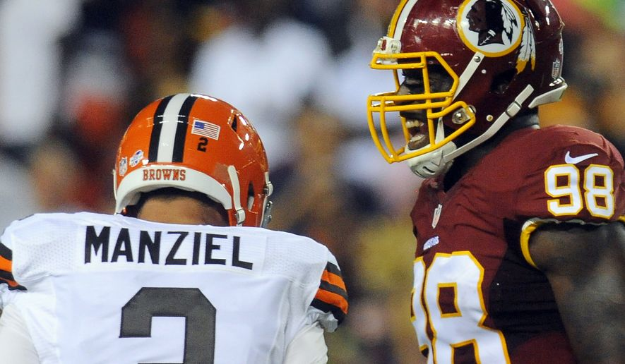 Washington Redskins outside linebacker Brian Orakpo (98) reacts after Cleveland Browns quarterback Johnny Manziel (2) was sacked during the first half of an NFL preseason football game Monday, Aug. 18, 2014, in Landover, Md. (AP Photo/Richard Lipski)