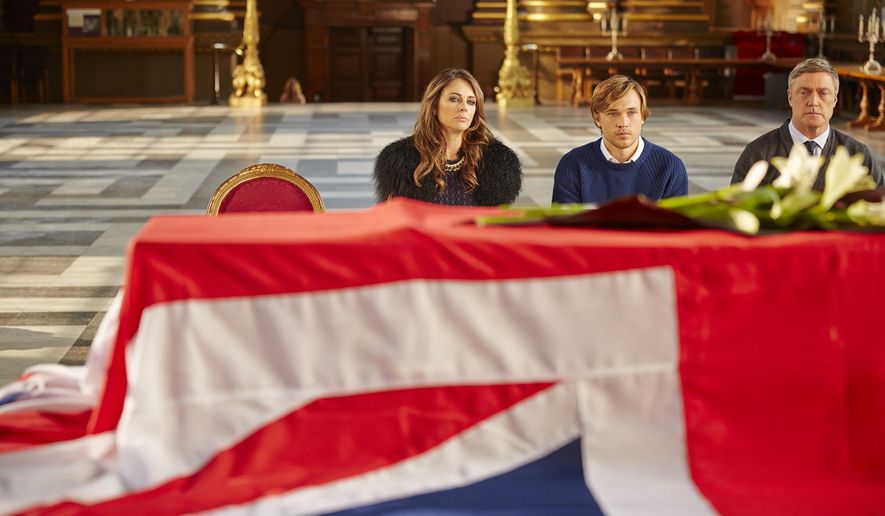 """This photo made available by E! Television shows Elizabeth Hurley as Queen Helena, the Queen of England, William Moseley as Prince Liam and Vincent Regan as King Simon, right, during filming of new television series """"The Royals.""""in a new TV drama series """"The Royals"""" which is currently filming and being set in London. The show is due for transmission in early 2015. (AP Photo/E! Television, James Dimmock)"""