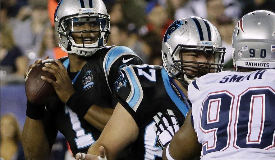 Carolina Panthers quarterback Cam Newton, left, looks for a receiver against a rush by New England Patriots defensive end Will Smith (90) in the first half of an NFL preseason football game Friday, Aug. 22, 2014, in Foxborough, Mass. (AP Photo/Stephan Savoia)