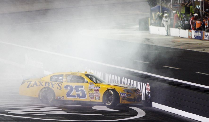 John Wes Townley near the inside wall during the NASCAR Nationwide series auto race at Bristol Motor Speedway on Friday, Aug. 22, 2014, in Bristol, Tenn. (AP Photo/Wade Payne)