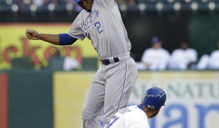 Kansas City Royals shortstop Alcides Escobar (2) jumps to catch the pickoff throw against Texas Rangers Alex Rios (51) at second base during the first inning of a baseball game Friday, Aug. 22, 2014, in Arlington, Texas. (AP Photo/LM Otero)