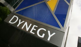 FILE - This March 8, 2006 file photo shows the Dynegy Inc. headquarters in Houston. Dynegy on Friday, Aug. 22, 2014 announced plans to spend more than $6 billion to buy several coal and gas power generation plants from Duke Energy and Energy Capital Partners. (AP Photo/David J. Phillip, File)