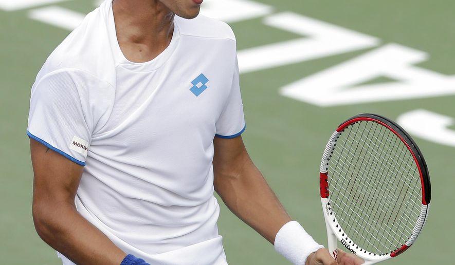 Lukas Rosol, of Czech Republic, reacts after defeating Yen-Hsun Lu, of Taiwan, in their semi-final match at the Winston-Salem Open tennis tournament in Winston-Salem, N.C., Friday, Aug. 22, 2014. Rosol defeated Lu 7-5, 4-6, 6-4. (AP Photo/Chuck Burton)