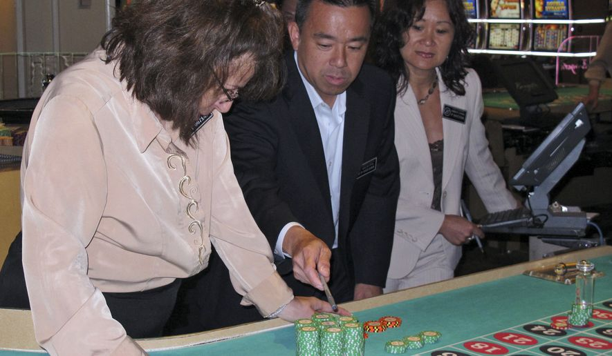 In this photo taken June 26, 2013, a dealer and two supervisors count gambling chips for a winning roulette bet at the Borgata Hotel Casino & Spa in Atlantic City N.J. Figures released on Aug. 22, 2014, show the city's 11 casinos saw their gross operating profit increase by 35 percent in the second quarter of this year, but most of that improvement was due to the Borgata, which got a big property tax refund from the city. (AP Photo/Wayne Parry)