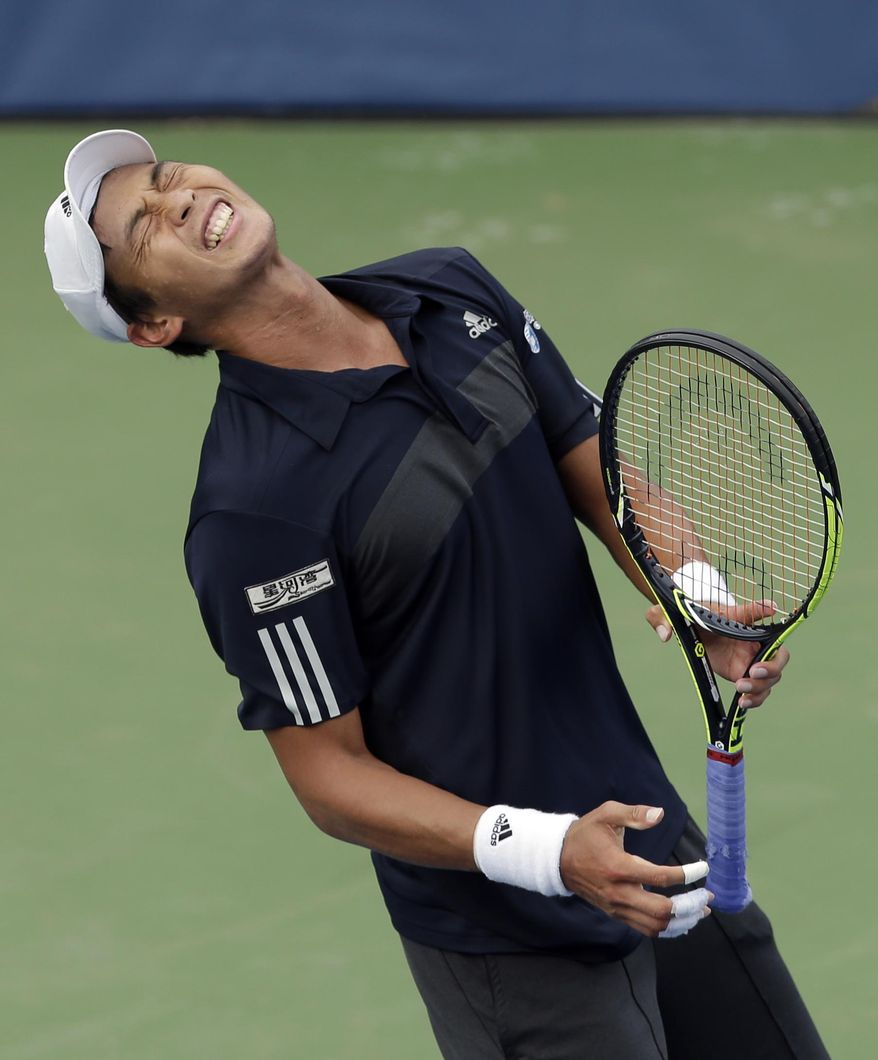 Yen-Hsun Lu, of Taiwan, reacts after losing a point in the final game against Lukas Rosol, of Czech Republic, in their semi-final match at the Winston-Salem Open tennis tournament in Winston-Salem, N.C., Friday, Aug. 22, 2014. Rosol defeated Lu 7-5, 4-6, 6-4. (AP Photo/Chuck Burton)