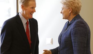 U.S. Sen. Bill Nelson, D-Fla., left,  speaks to the  Lithuania's President Dalia Grybauskaite  prior to their meeting at the President palace in Vilnius, Lithuania, Friday, Aug. 22, 2014.  (AP Photo/Mindaugas Kulbis)