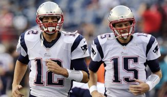 New England Patriots quarterback Tom Brady (12) and quarterback Ryan Mallett, run before an NFL preseason football game Friday, Aug. 22, 2014, in Foxborough, Mass. (AP Photo/Charles Krupa)