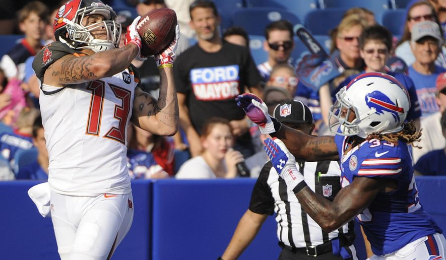 Tampa Bay Buccaneers wide receiver Mike Evans (13) catches a pass in front of Buffalo Bills' Ron Brooks (33) for a touchdown during the first half of a preseason NFL football game Saturday, Aug. 23, 2014, in Orchard Park, N.Y. The Buccaneers won the game 27-14. (AP Photo/Gary Wiepert)