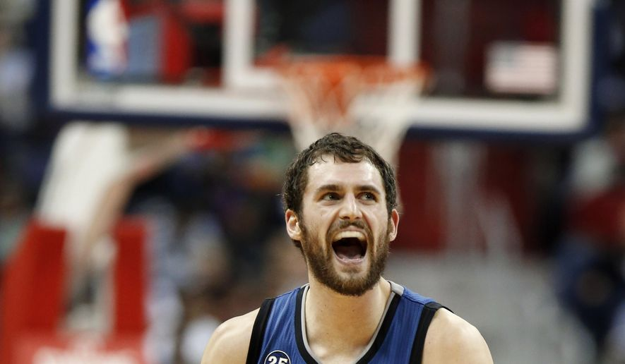 ** FILE ** Minnesota Timberwolves forward Kevin Love (42) reacts in the second half of an NBA basketball game against the Washington Wizards in Washington,  Nov. 19, 2013. (Associated Press)