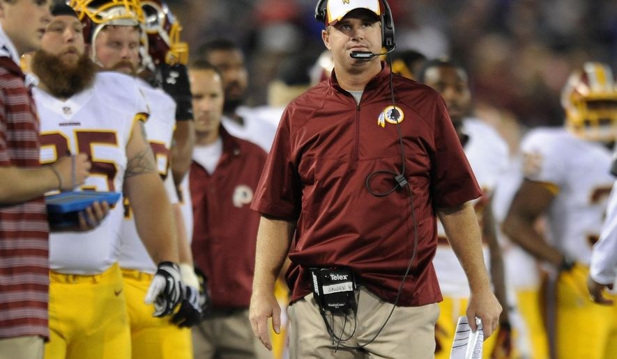 Washington Redskins head coach Jay Gruden watches from the sideline in the first half of an NFL preseason football game against the Baltimore Ravens, Saturday, Aug. 23, 2014, in Baltimore. (AP Photo/Gail Burton)