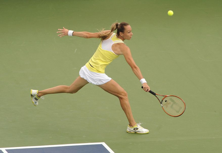 Magdalena Rybarikova, of Slovakia, stretches to return a serve during her 6-4, 6-2 loss to Petra Kvitova, of the Czech Republic, in the final match of the Connecticut Open tennis tournament in New Haven, Conn., on Saturday, Aug. 23, 2014. (AP Photo/Fred Beckham)