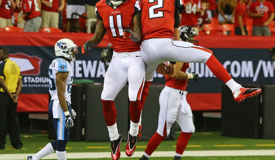 Atlanta Falcons quarterback Matt Ryan (2) and wide receiver Julio Jones celebrate a touchdown pass against the Tennessee Titans during the second quarter of an NFL preseason football game Saturday, Aug. 23, 2014, in Atlanta. (AP Photo/Atlanta Journal Constitution, Curtis Compton)