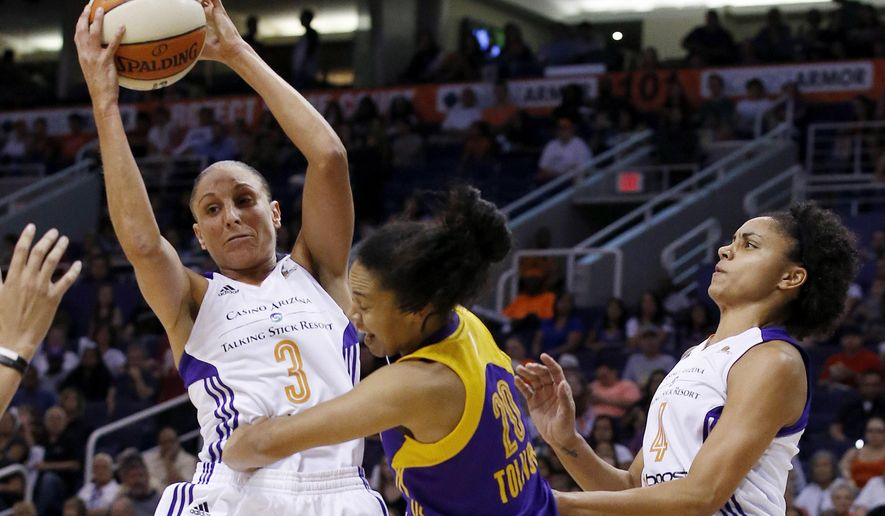 Phoenix Mercury's Diana Taurasi (3) grabs a rebound in front of Los Angeles Sparks' Kristi Toliver (20) as Mercury's Candice Dupree (4) looks on during the first half in Game 1 of the WNBA basketball Western Conference semifinals Friday, Aug. 22, 2014, in Phoenix. (AP Photo/Ross D. Franklin)