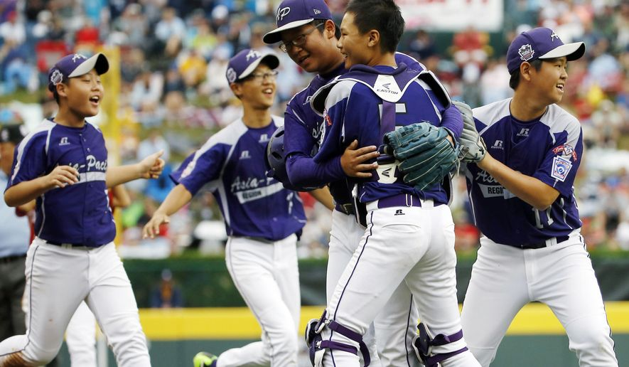 South Korea players celebrate after defeating Japan 12-3 in the International Championship baseball game at the Little League World Series, Saturday, Aug. 23, 2014, in South Williamsport, Pa.(AP Photo/Matt Slocum)