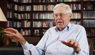 This photo taken May 22, 2012, shows Charles Koch in his office at Koch Industries in Wichita, Kansas, where Koch Industries manages 60,000 employees in 60 countries. (AP Photo/The Wichita Eagle, Bo Rader)