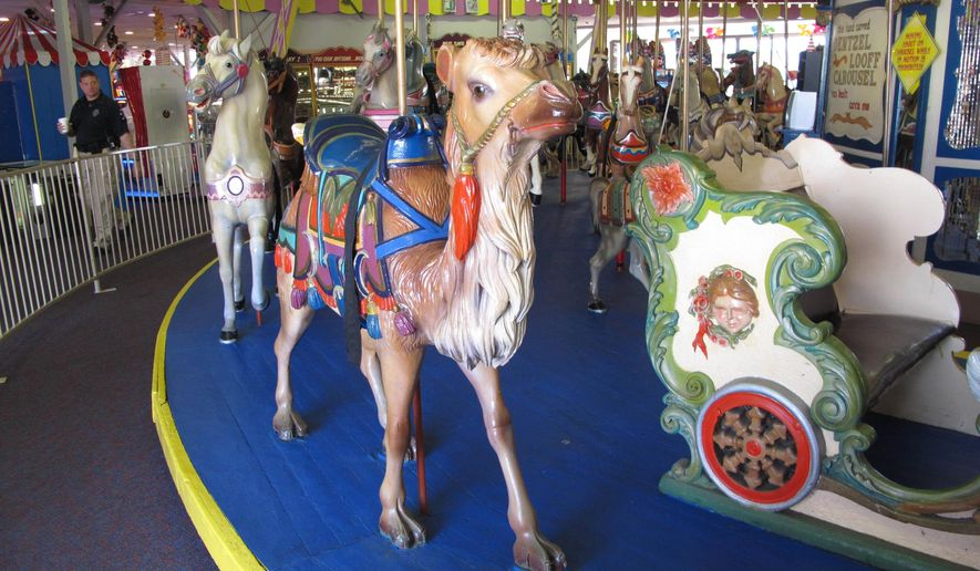 FILE- In this July 21, 2014 file photo, one of the 58 hand-painted animals on the Seaside Heights N.J. carousel is shown. The owners of Casino Pier in Seaside Heights decided to auction off the iconic carousel in July 2014, saying the economy forced them to look for a new home for the ride. (AP Photo/Wayne Parry, File)