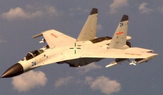 """This handout photo provided by the Office of the Defense Secretary (OSD), taken Aug. 19, 2014,  shows a Chinese fighter jet that the Obama administration said Friday conducted a """"dangerous intercept"""" of a U.S. Navy surveillance and reconnaissance aircraft off the coast of China in international airspace.  (AP Photo/OSD)"""
