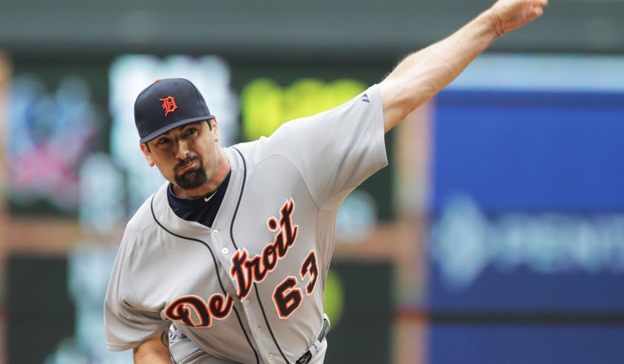 Detroit Tigers pitcher Patrick McCoy throws against the Minnesota Twins in the second inning of a baseball game against the Minnesota Twins, Saturday,  Aug. 23, 2014, in Minneapolis. (AP Photo/Jim Mone)