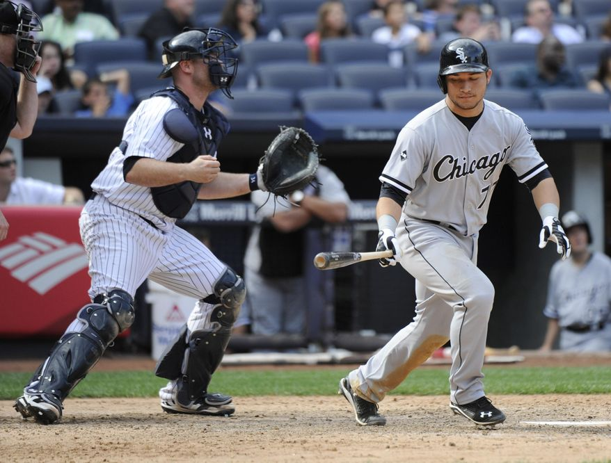 New York Yankees catcher Brian McCann, left, reacts as Chicago White Sox batter Carlos Sanchez pops out to end the baseball game Saturday, Aug. 23, 2014, at Yankee Stadium in New York. The Yankees won 5-3. (AP Photo/Bill Kostroun)