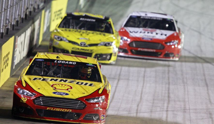 Driver Joey Logano (22) leads Matt Kenseth (20) and Brad Keselowski (2) during a NASCAR Sprint Cup Series auto race at Bristol Motor Speedway on Saturday, Aug. 23, 2014, in Bristol, Tenn. (AP Photo/Wade Payne)