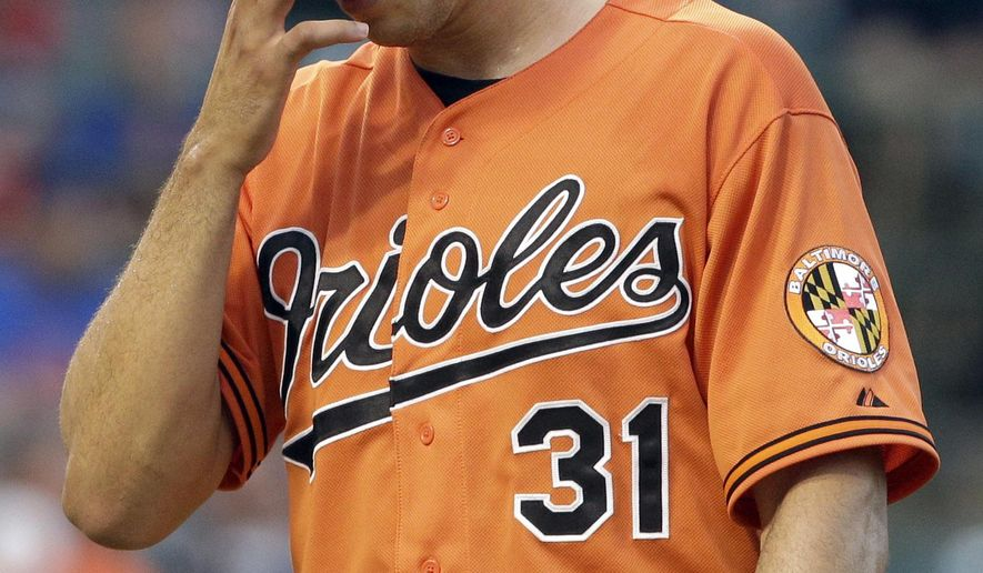 Baltimore Orioles relief pitcher Ubaldo Jimenez walks back to the dugout after the sixth inning of an interleague baseball game against the Chicago Cubs in Chicago, Saturday, Aug. 23, 2014. (AP Photo/Nam Y. Huh)