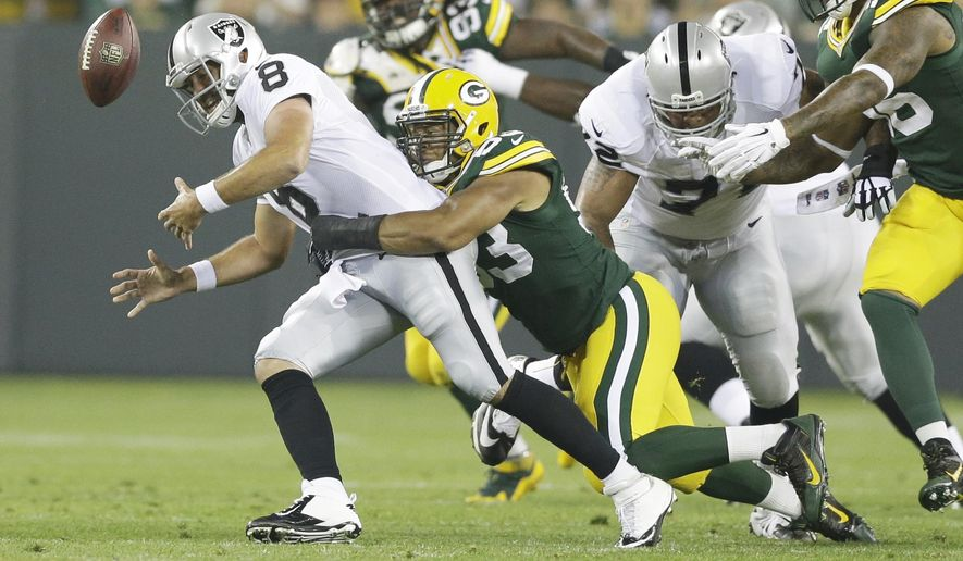 Oakland Raiders quarterback Matt Schaub (8) fumbles as he is hit by Green Bay Packers' Nick Perry during the first half of an NFL preseason football game Friday, Aug. 22, 2014, in Green Bay, Wis. The Packers recovered the fumble. (AP Photo/Tom Lynn)