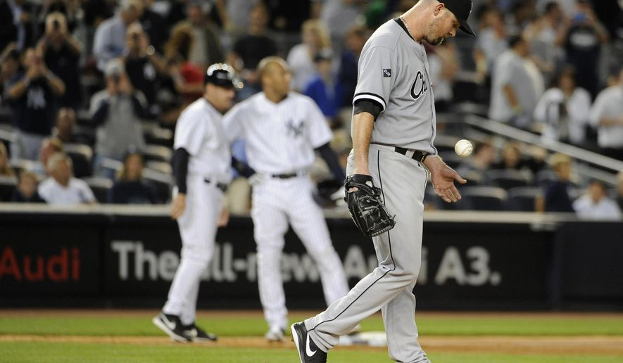 Chicago White Sox starting pitcher John Danks reacts after New York Yankees' Jacoby Ellsbury hit an RBI double in the fifth inning of a baseball game at Yankee Stadium on Friday, Aug. 22, 2014, in New York. (AP Photo/Kathy Kmonicek)