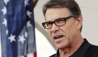 Texas Gov. Rick Perry, speaks at the Defend Freedom Pork Roast, Saturday, Aug. 23, 2014 in Rochester, N.H. It was Perry's second day visiting the nation's earliest presidential primary state as he considers another run for president. (AP Photo/Jim Cole)
