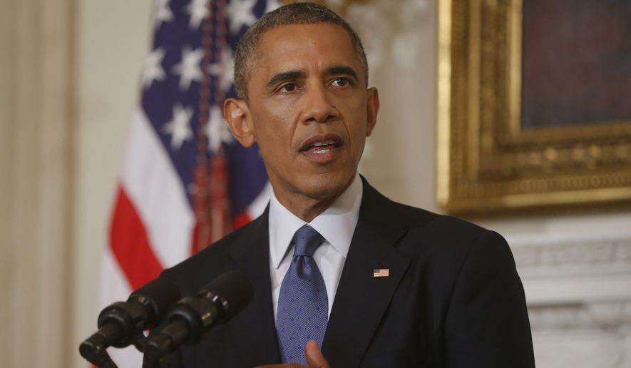 ** FILE ** This Aug. 7, 2014, file photo shows President Barack Obama talking about the situation in Iraq in the State Dining Room at the White House in Washington. (AP Photo/Charles Dharapak, File)